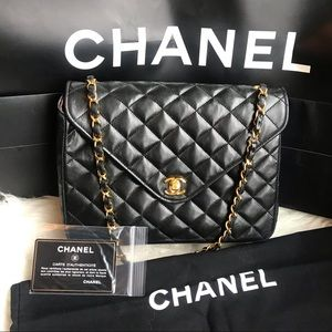 Authentic CHANEL black round Lambskin